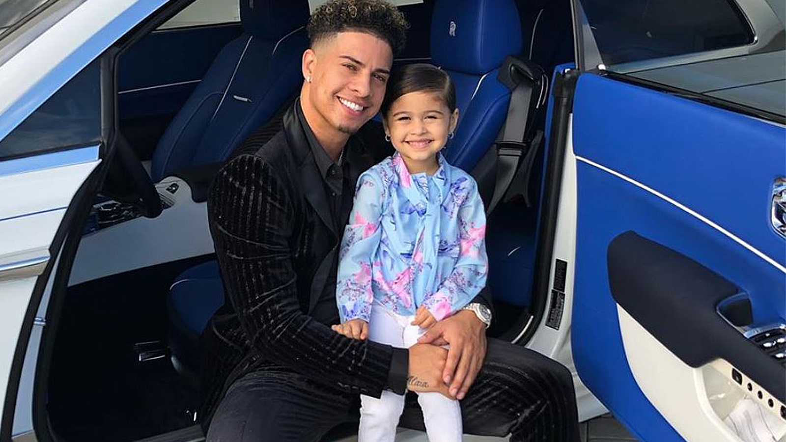 ACE Family's Austin McBroom poses with daughter Elle in a car.