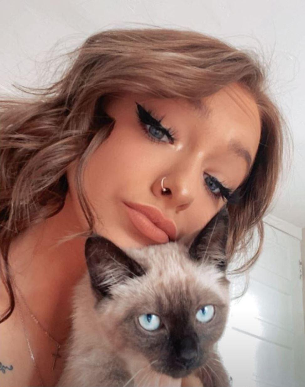 Zoe Laverne cuddles her pet kitten