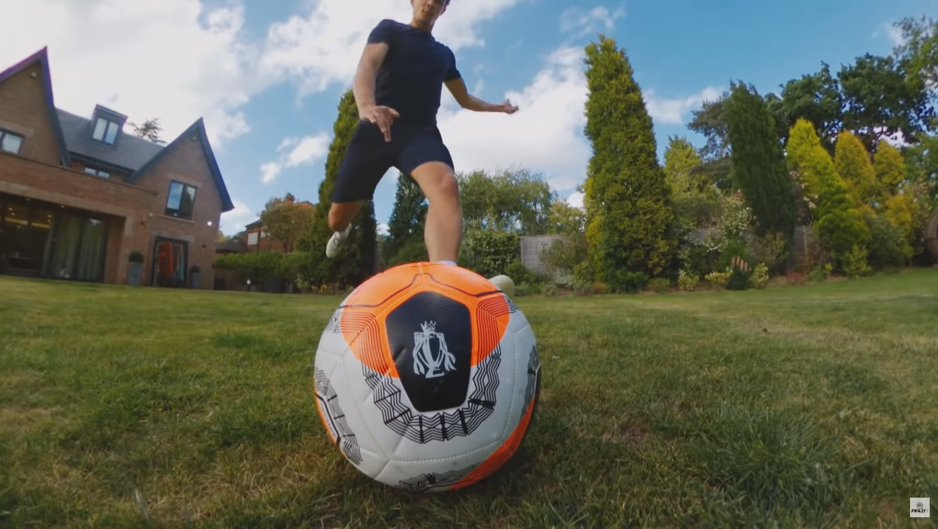 Trent Alexander-Arnold kicks a ball in the FIFA 21 reveal trailer.