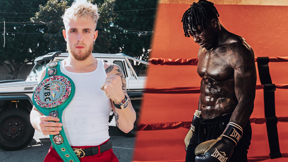 Jake Paul poses with a championship belt while Nate Robinson is poised in boxing attire.
