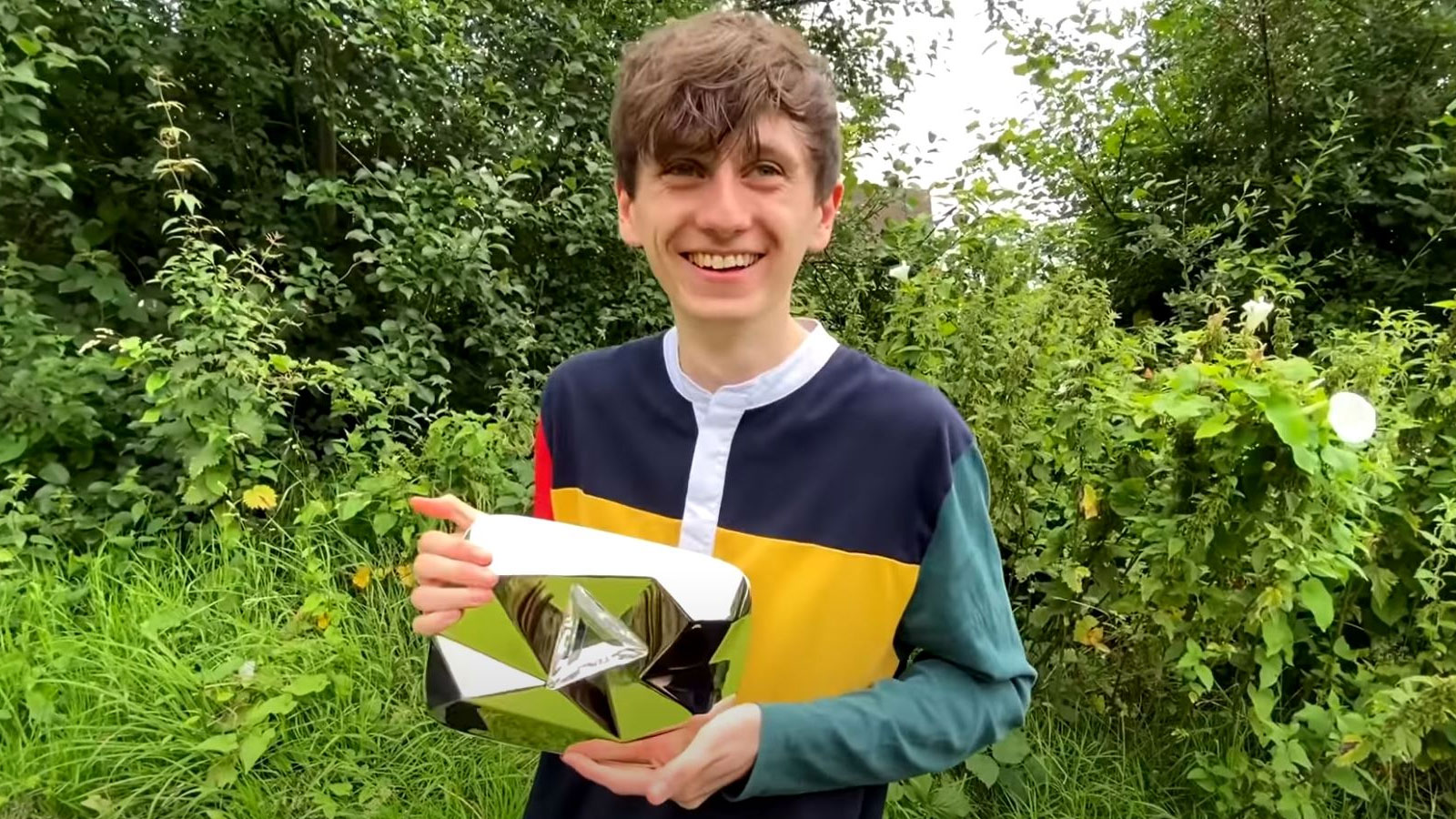 youtuber holding play button