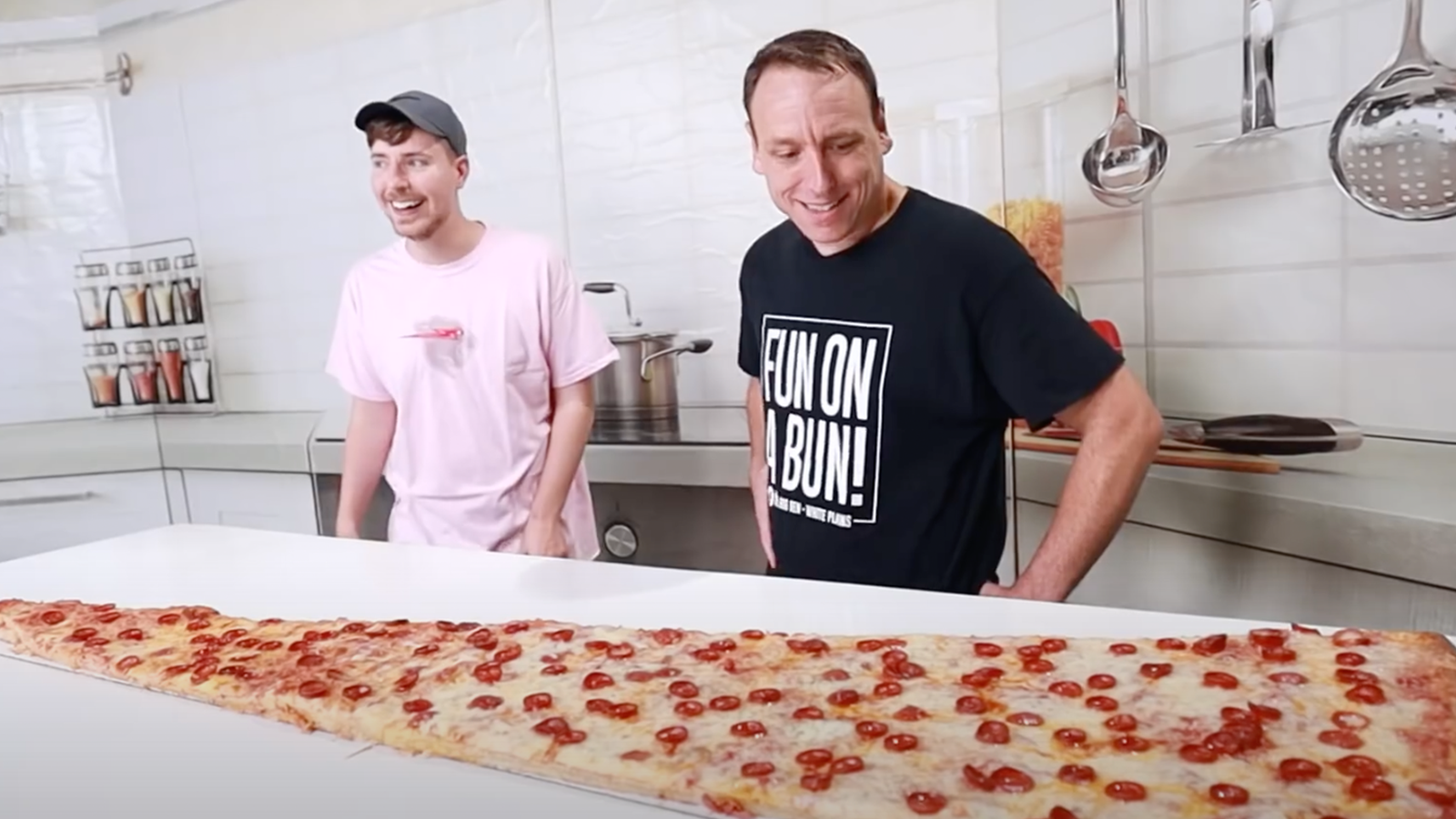 Joey Chestnut and Mr Beast, world's largest pizza slice
