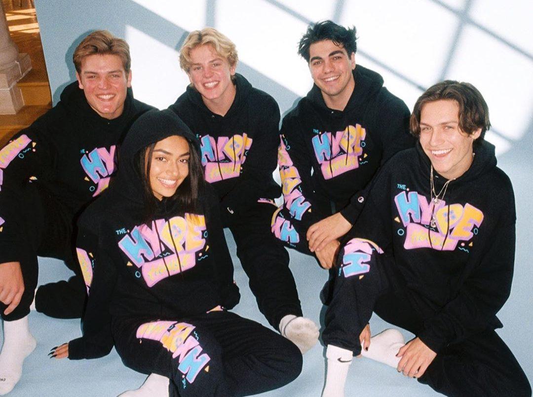 Hype House members wearing champion merch