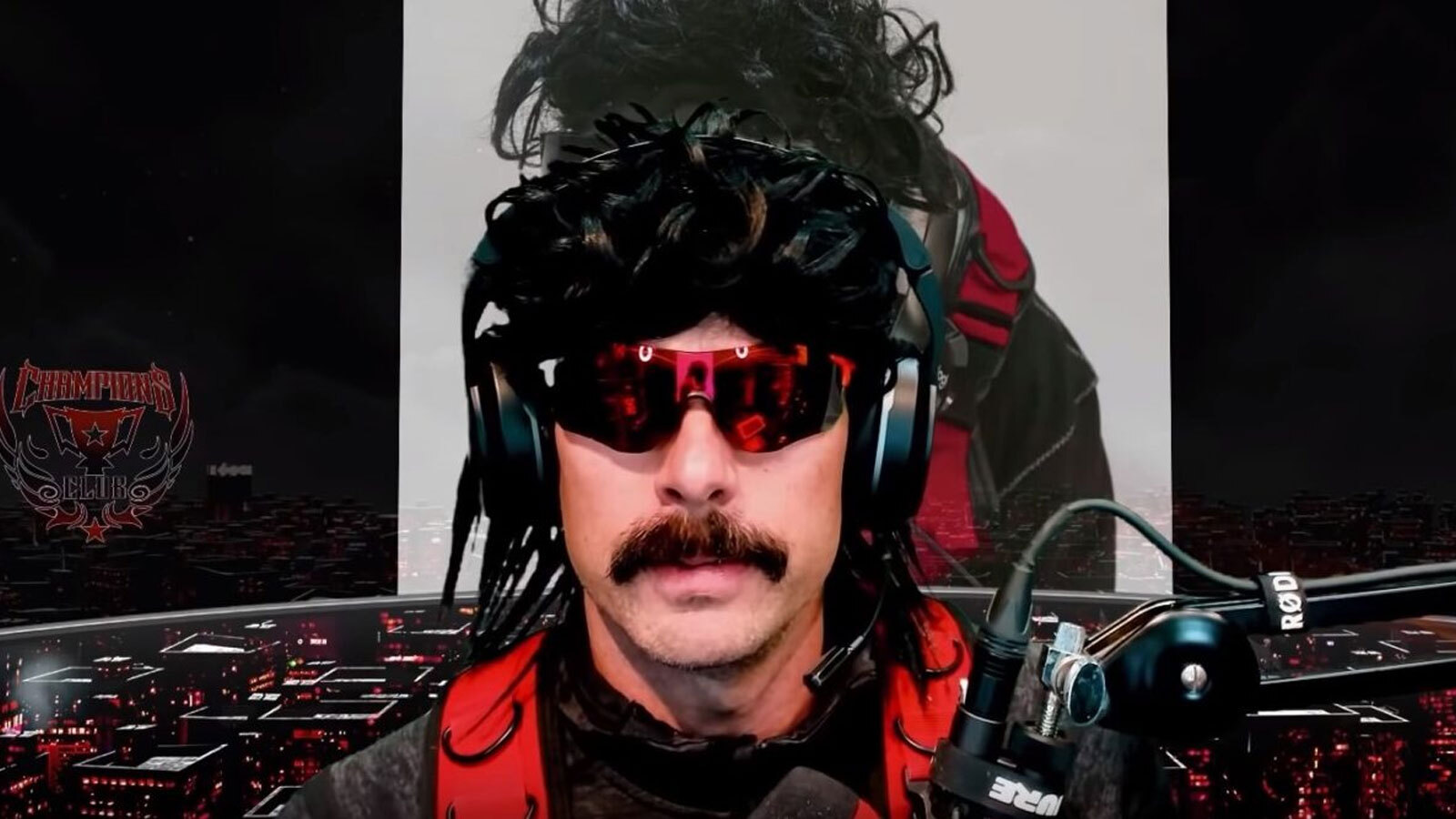 Dr Disrespect looks into the camera.