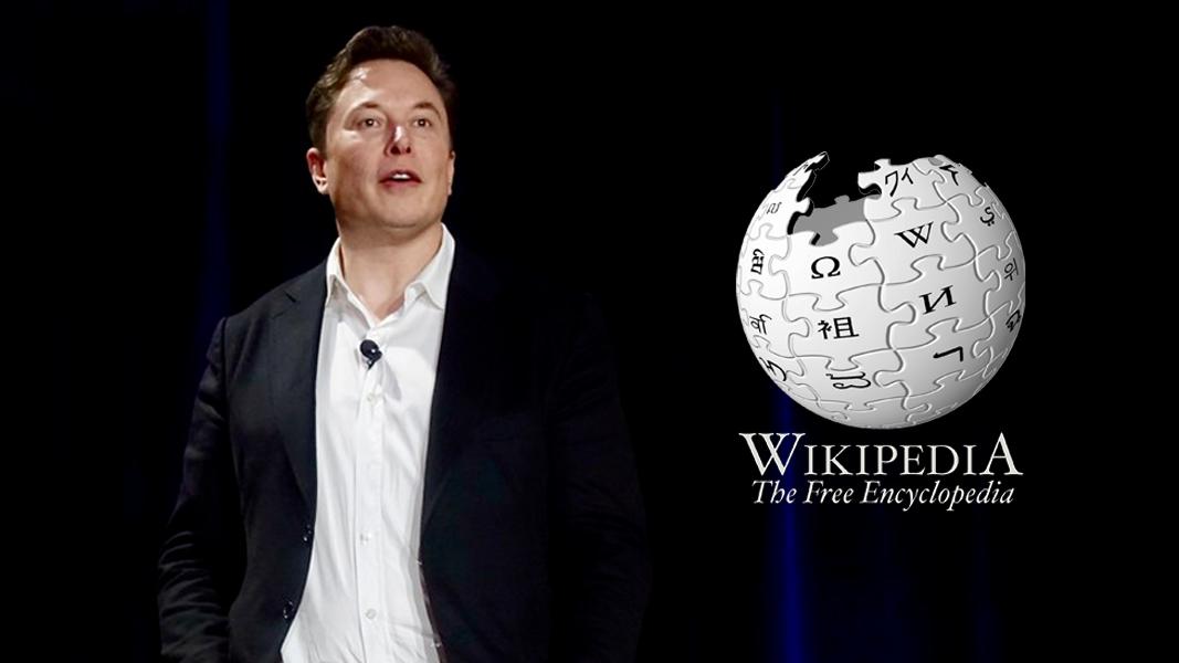 Elon Musk presenting next to Wikipedia logo