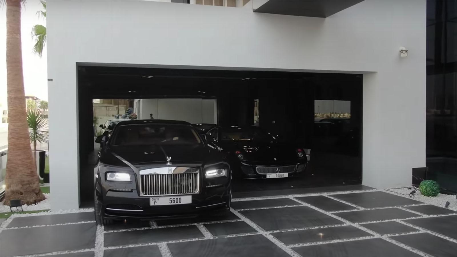 Rolls Royce and Ferrari in mansion garage