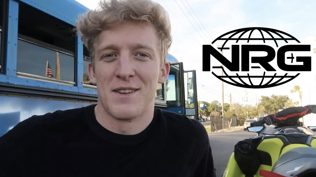 Tfue standing next to a real life battle bus with the NRG logo