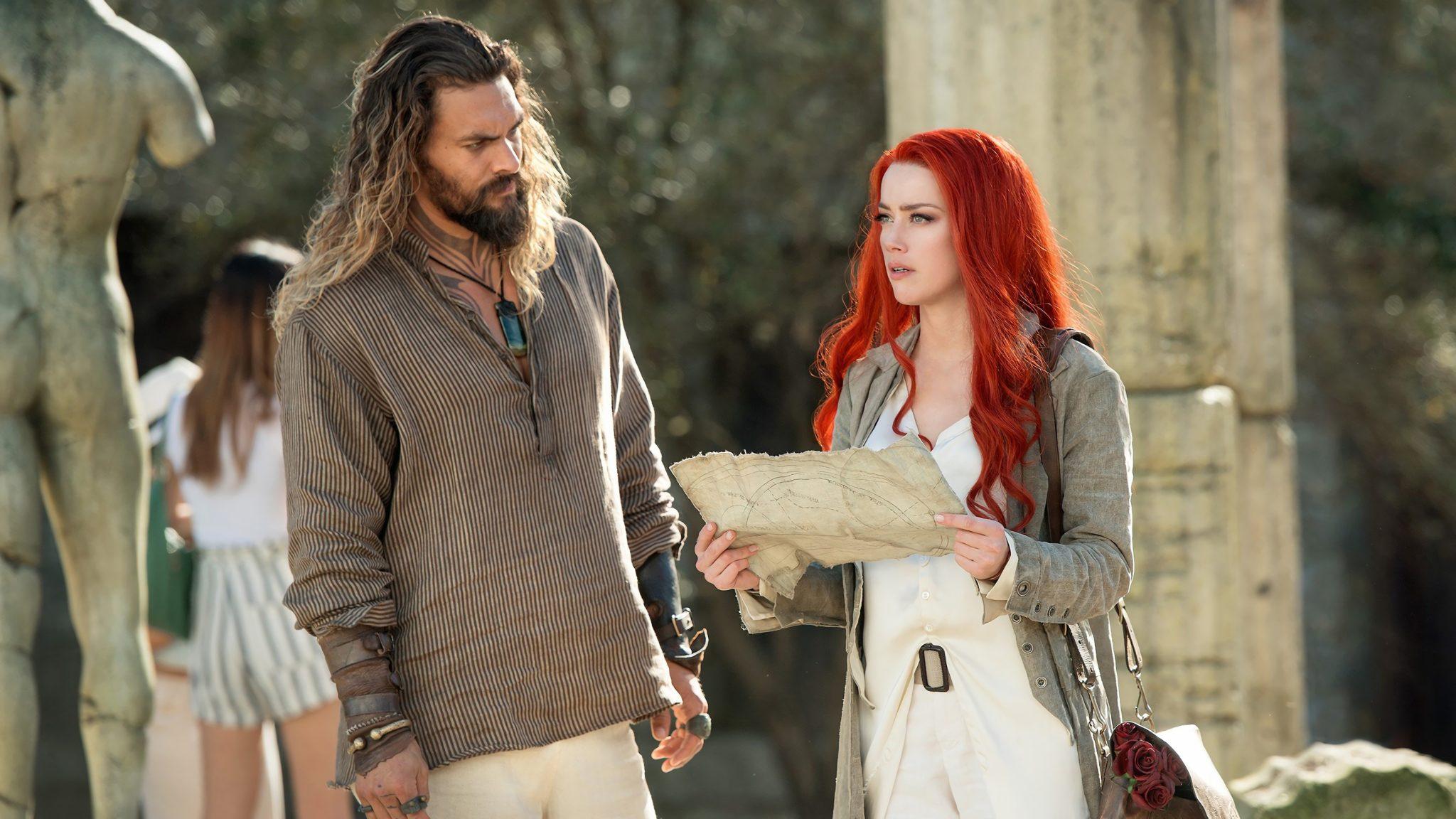 Amber Heard alongside co-star Jason Mamoa in Aquaman.
