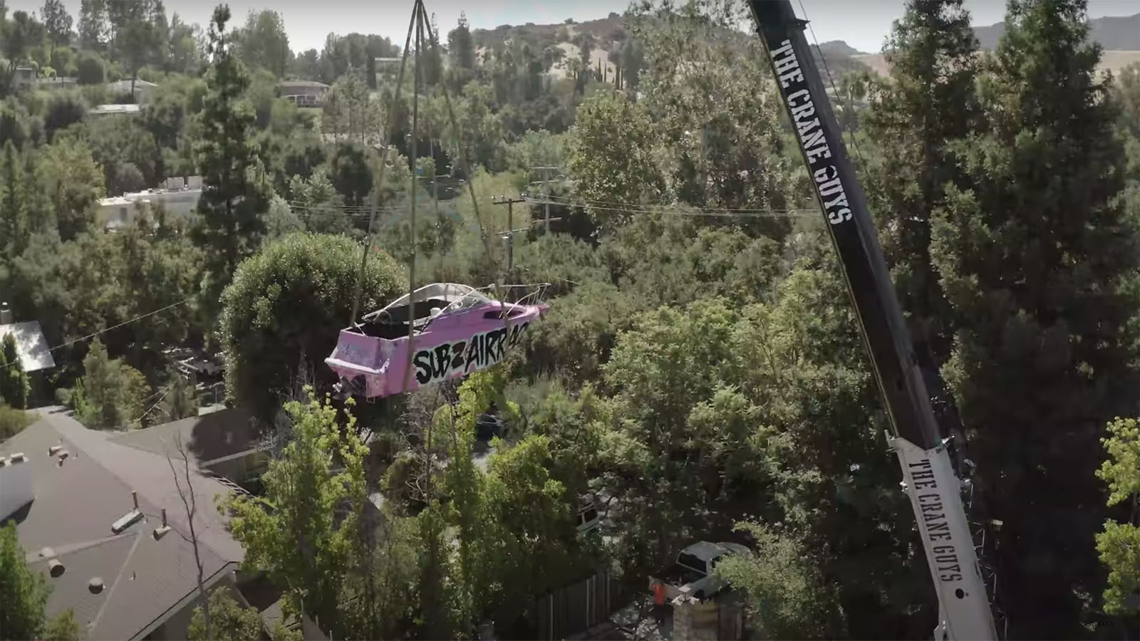 Airrack lifts pink yacht over Logan Paul's house