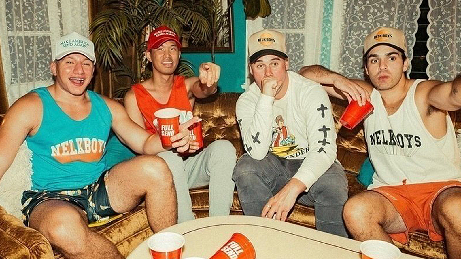The NELK Boys sit together while partying.