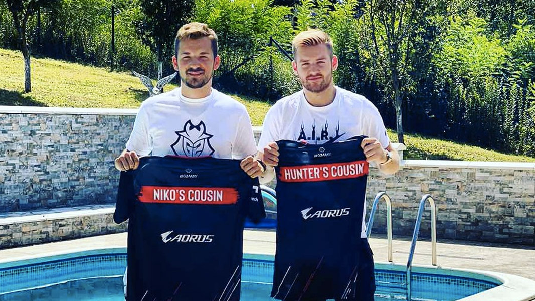 NiKo and Hunter holding shirts