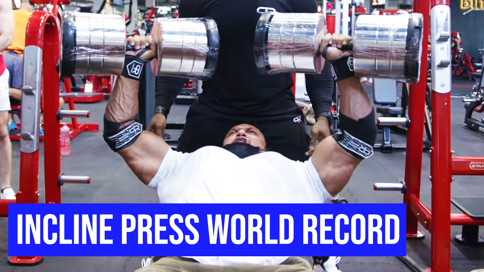 Larry Wheels pressing 242 lbs for reps.