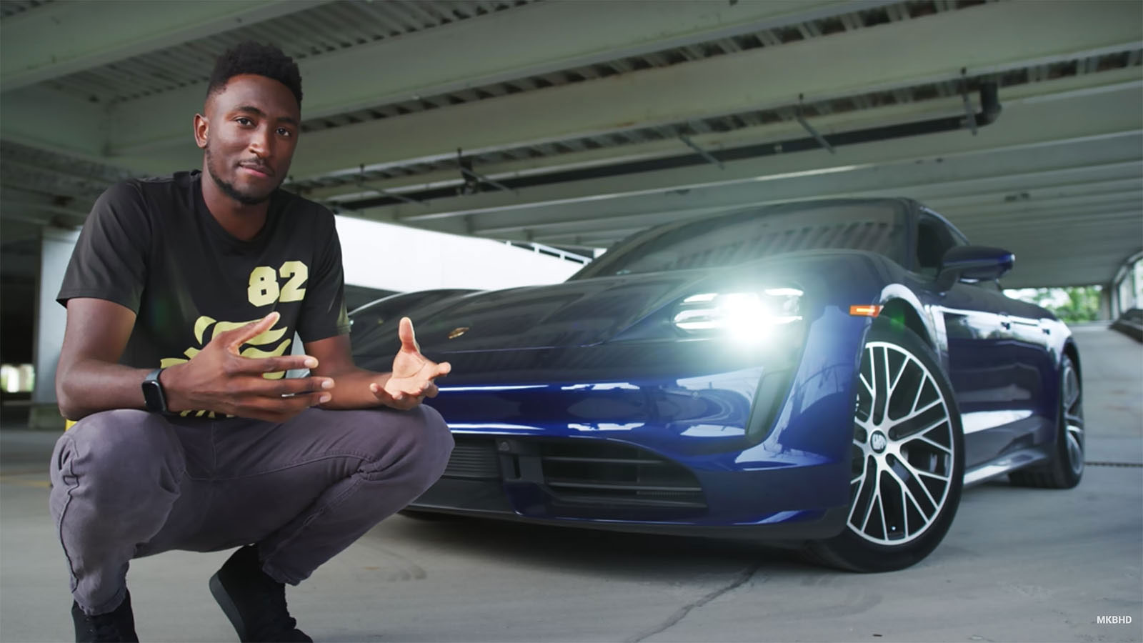 Marques Brownlee crouching in front of carYouTube: Marques Brownlee