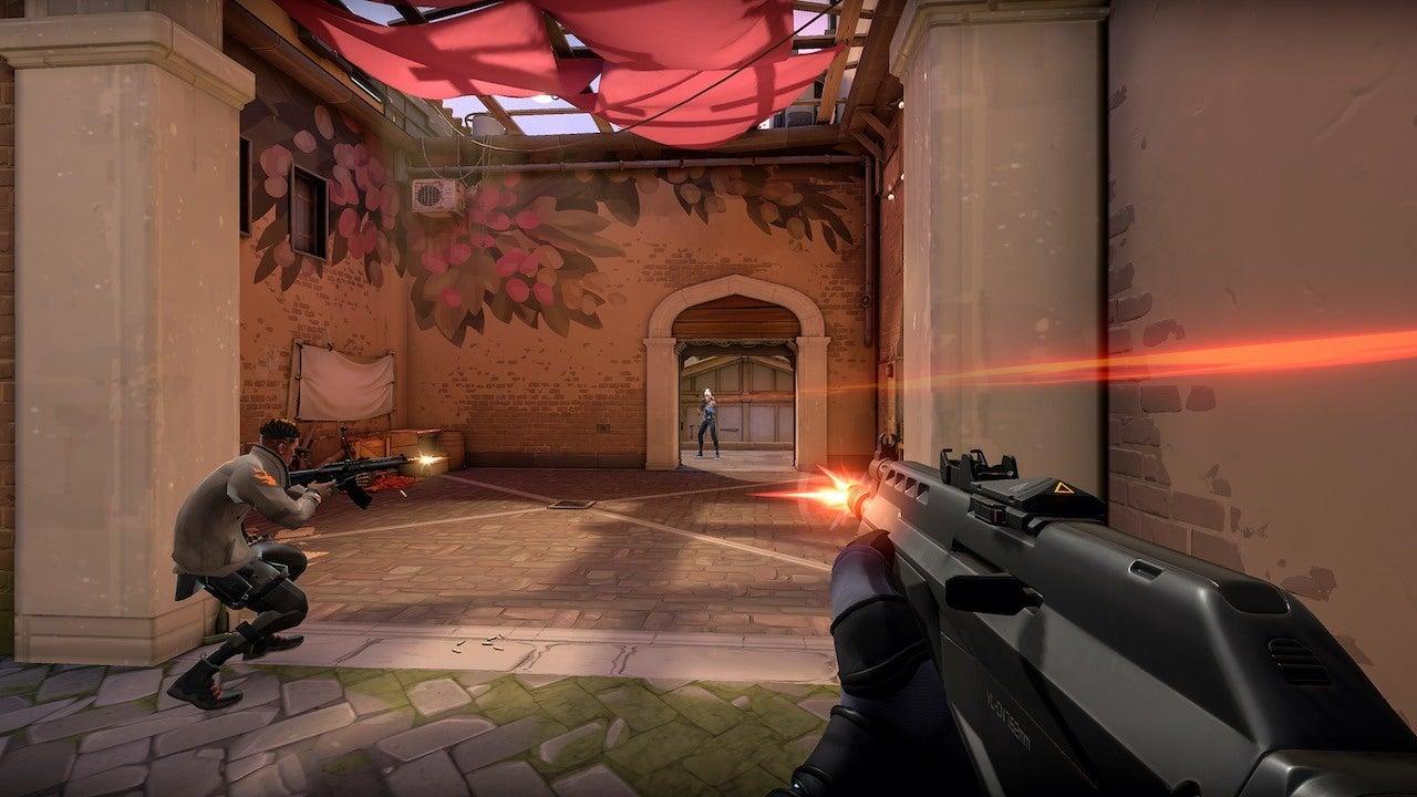 Valorant player shooting Jett on Ascent.