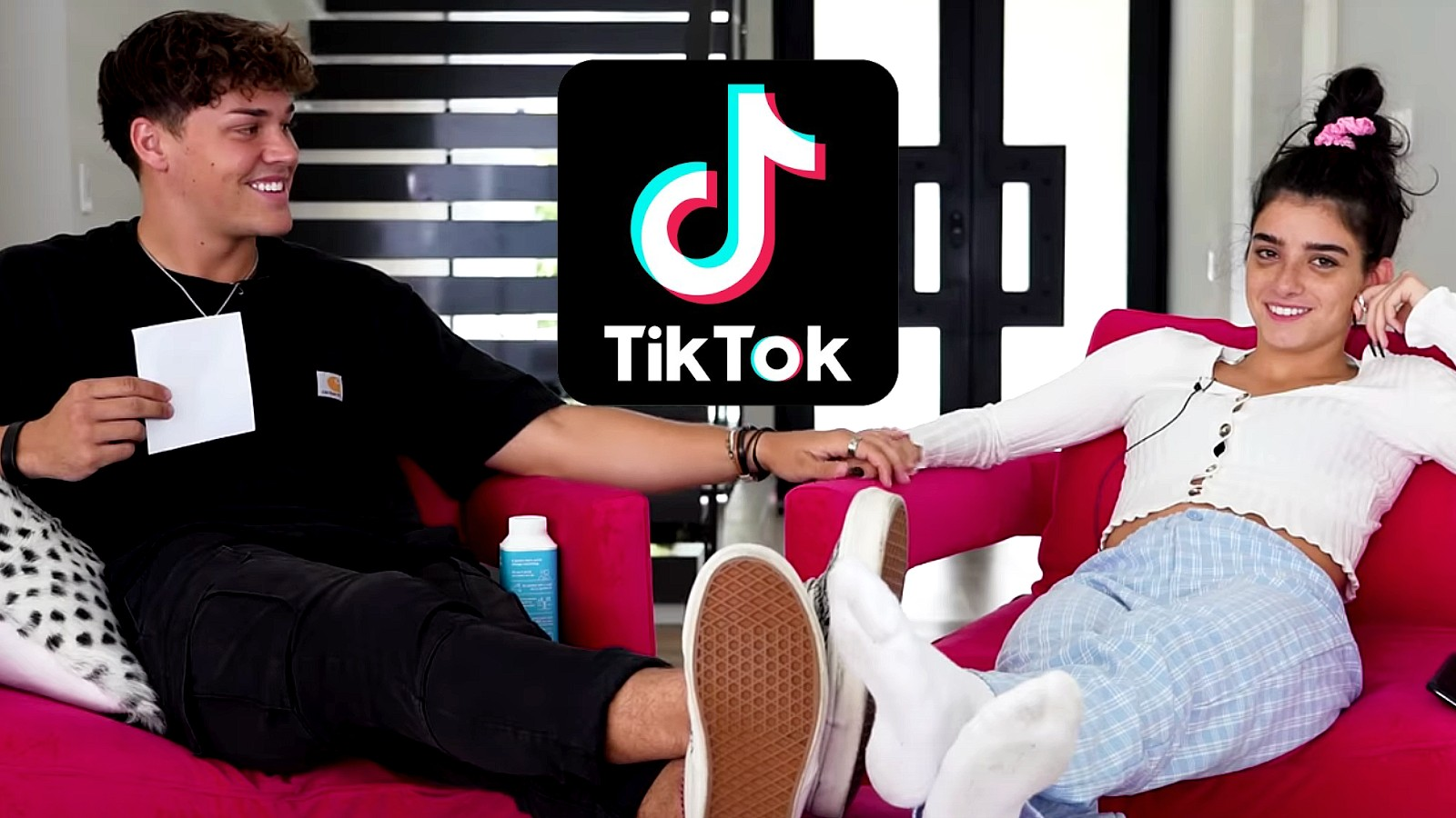 Dixie and Noah holding hands by TikTok logo