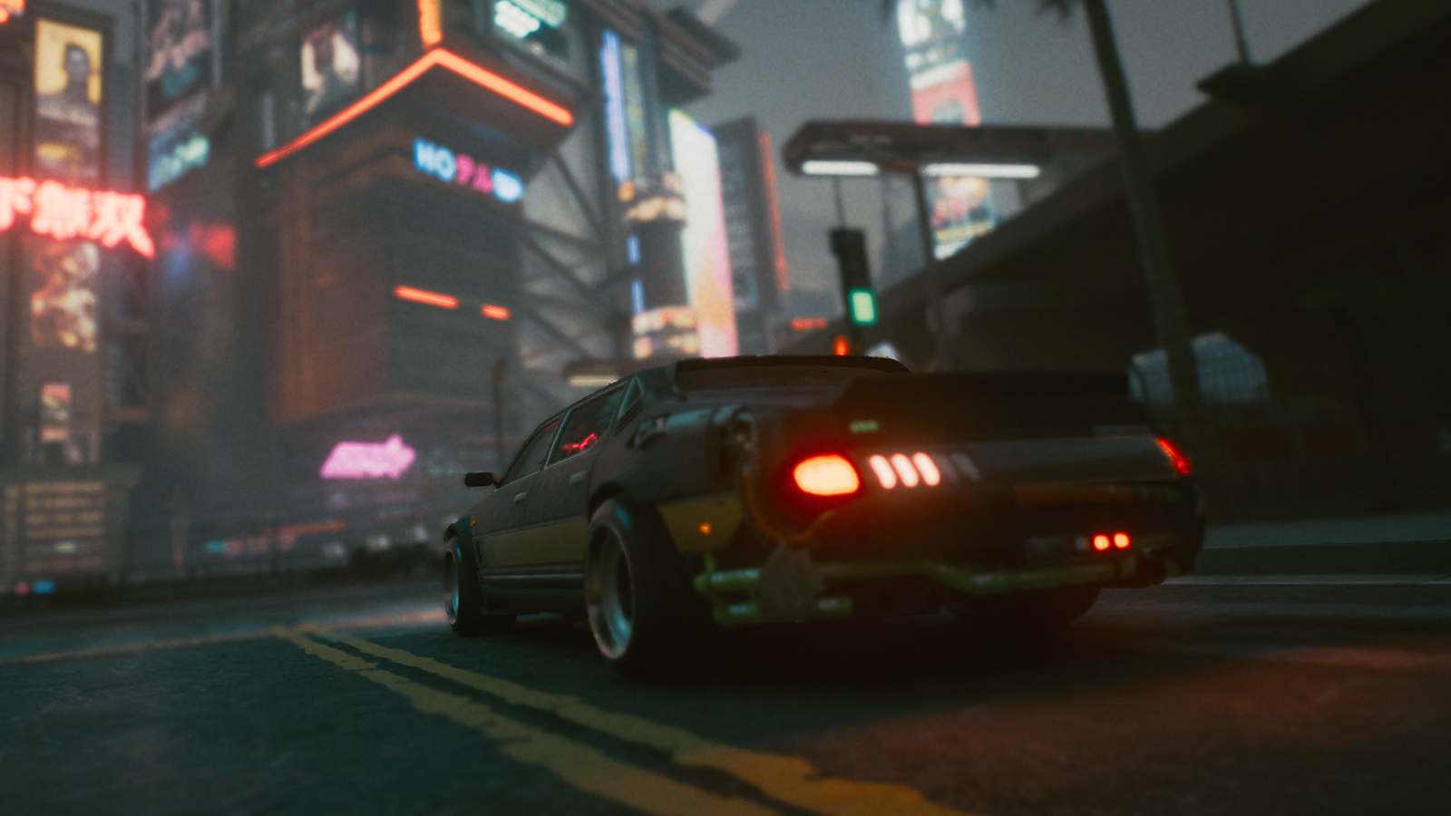 A car driving through Night City at night time in Cyberpunk 2077