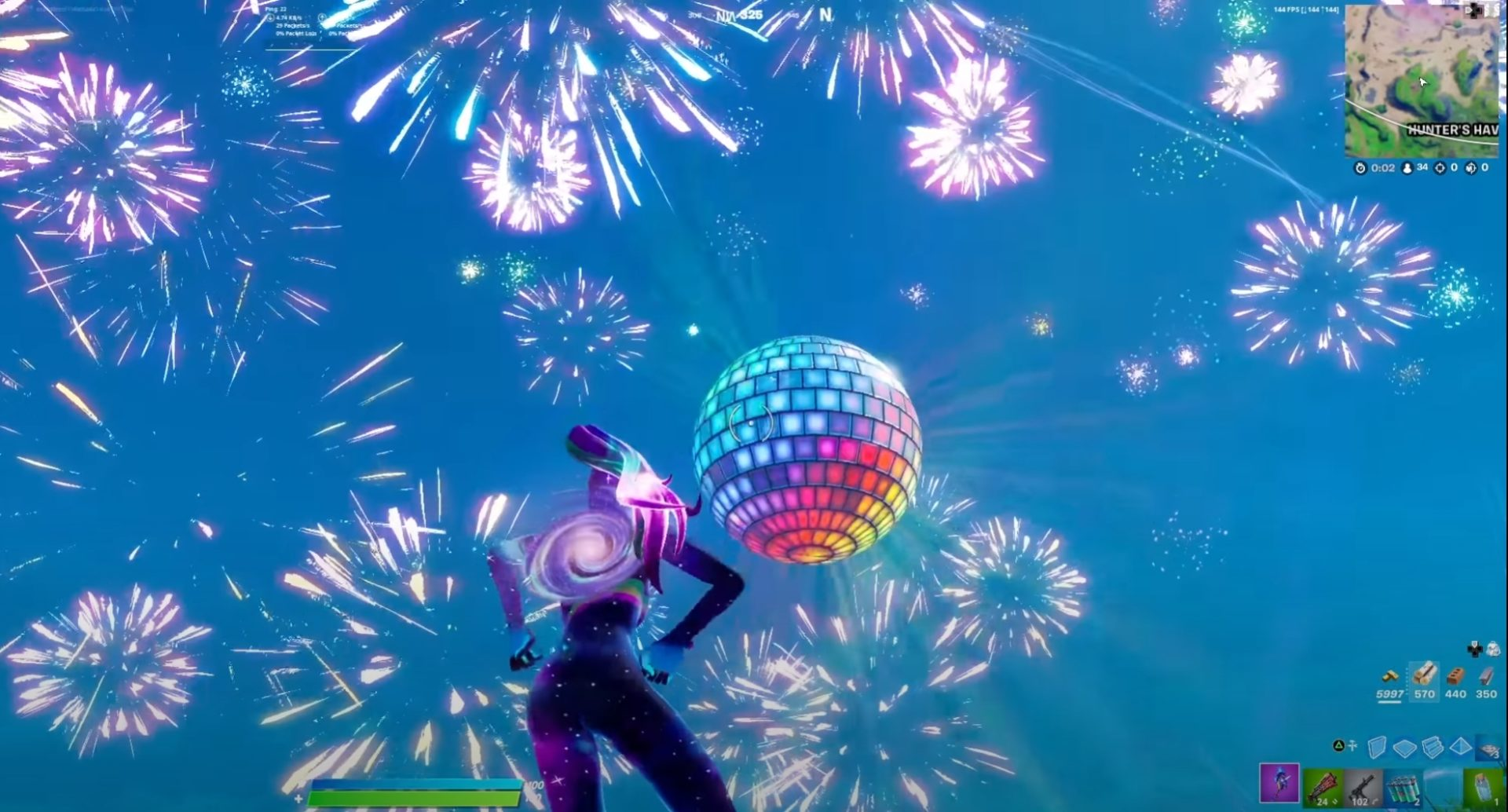 Fortnite's 2021 event with fireworks in the sky and a giant disco ball
