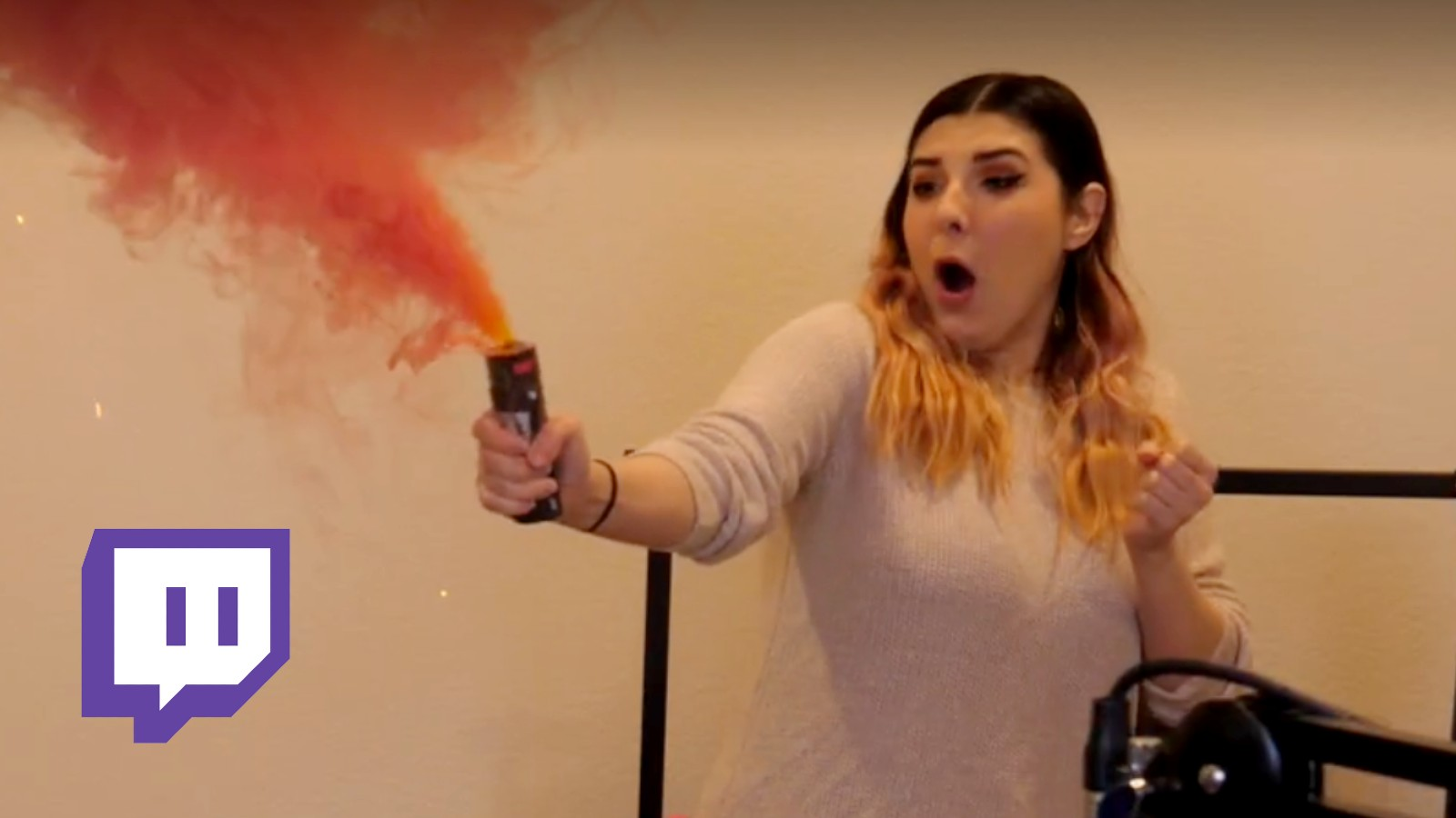 Twitch streamer holds smoke grenade with shocked face