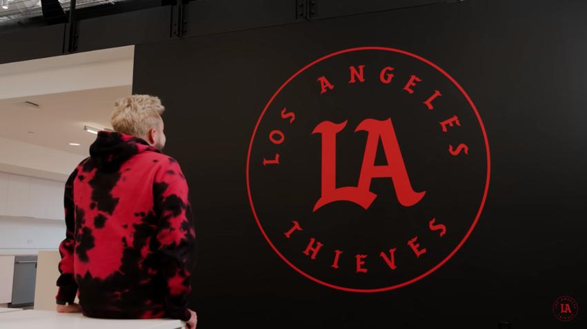 Nadeshot next to the Los Angeles Thieves logo