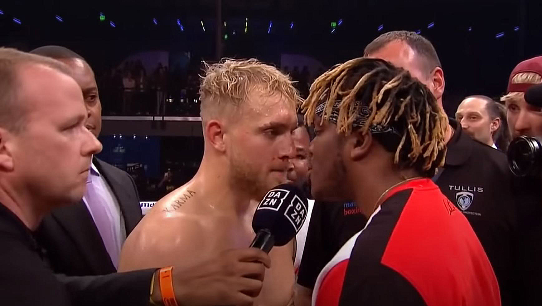 KSI faces off with Jake Paul in the boxing ring.