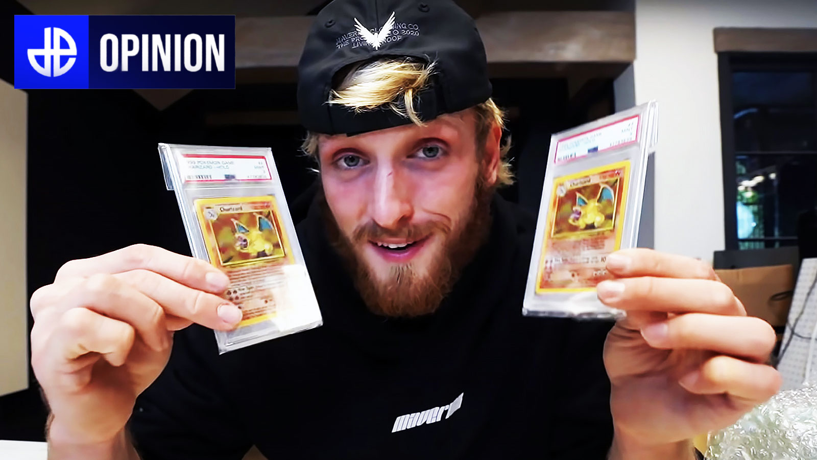logan paul posing with charizard cards