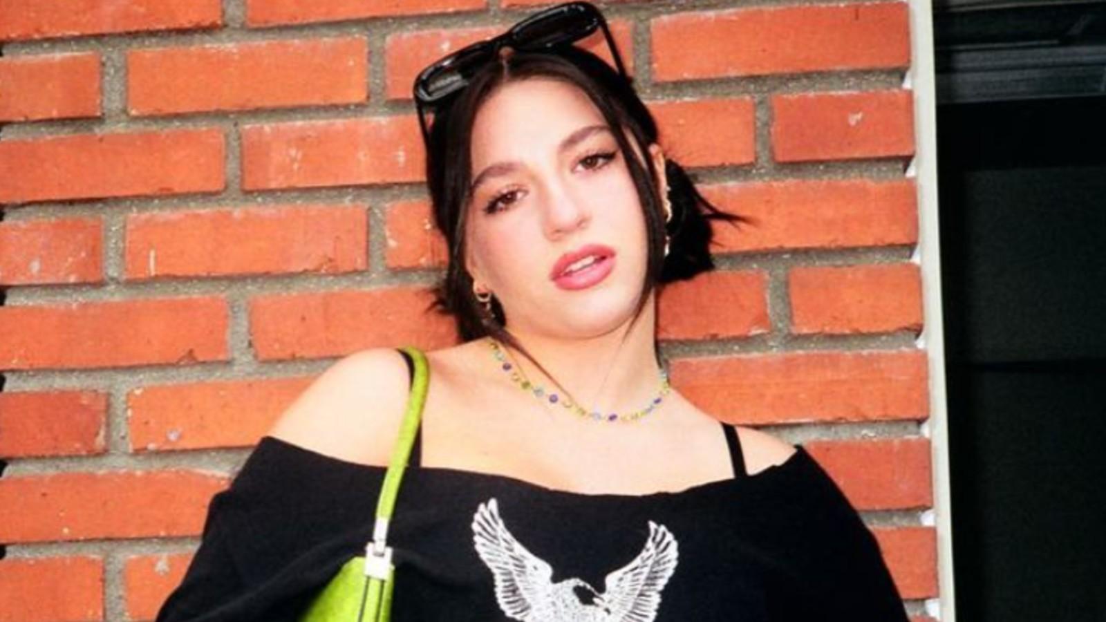 Kenzie Ziegler in front of a brick wall