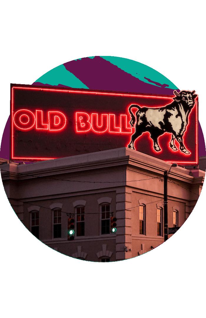 The neon Old Bull sign illuminated at sunset