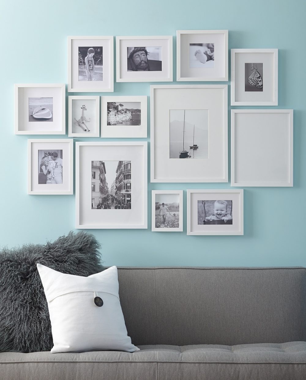Gallery Wall: Create an eye-catching gallery of your own photography. Use black-and-white prints and white frames hung close together to create a cohesive focal point. Move framed art around on a flat surface to find the best arrangement before mounting photos on a wall.