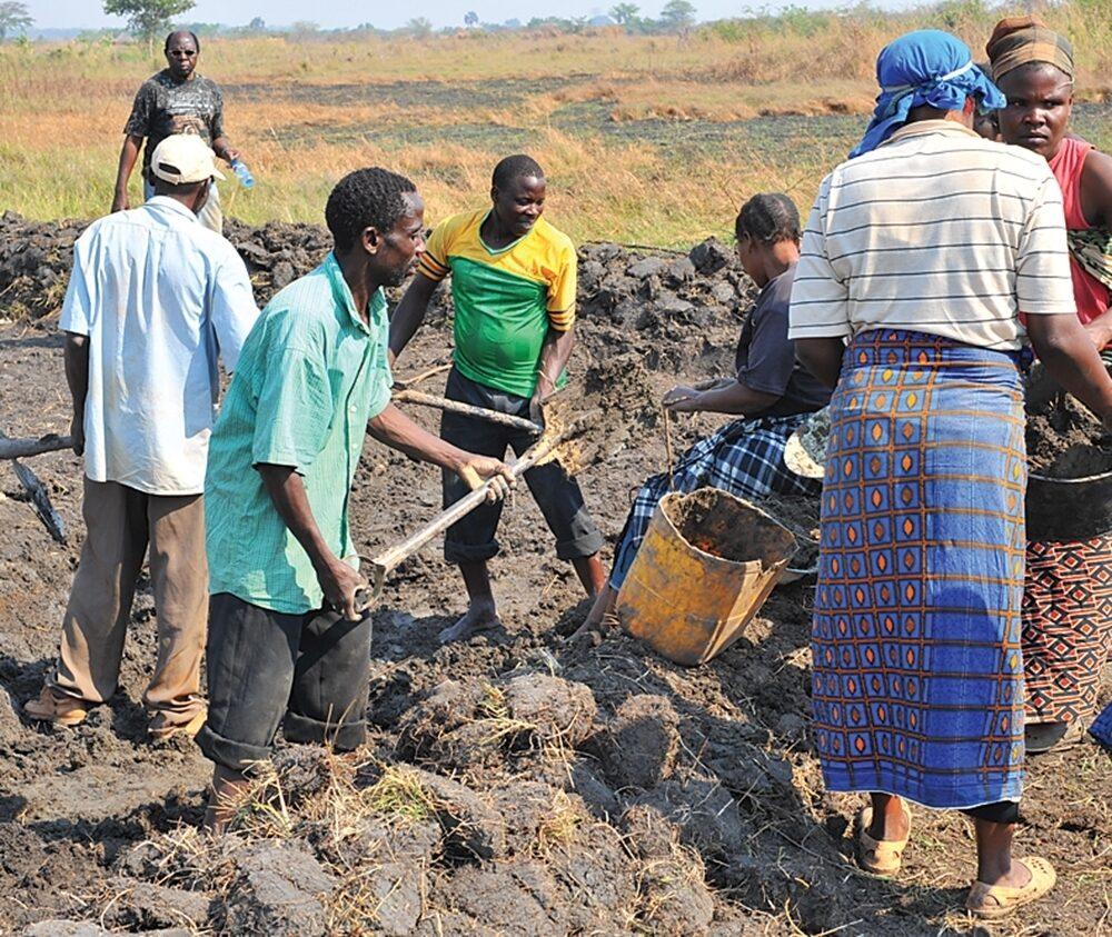 Residents work in Chishiko, a Zambia village.