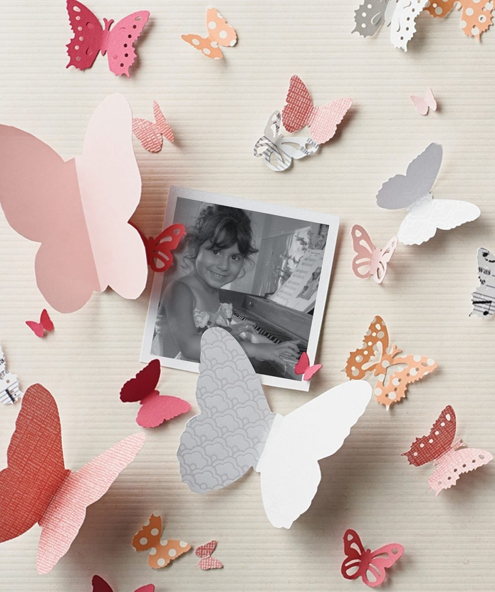 A photo of Makayla Sitton is surrounded by paper butterflies.