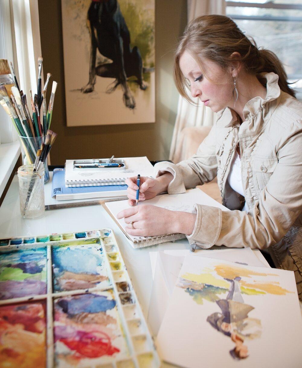 Jennifer Brandon, an illustrator for Lamplighter Publishing, sketches an illustration.