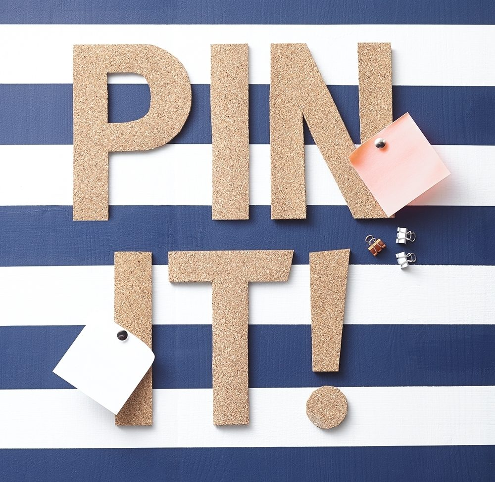 Cork letters spell out 'Pin it!'