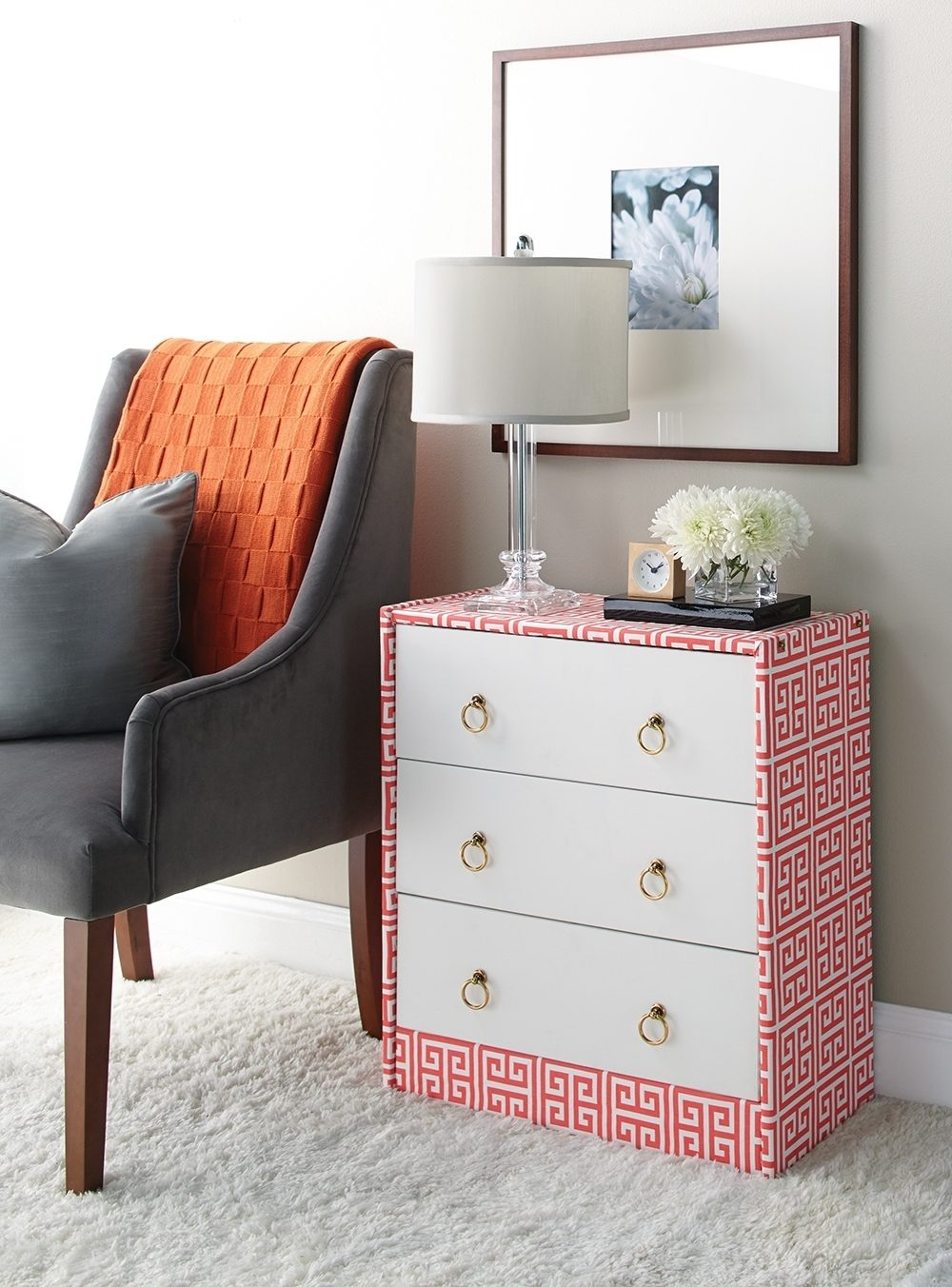Starting with a very basic dress, we gave it a splash of color with a trendy fabric. Drawer fronts were painted and brass ring pulls installed. Cost was under $80, including the dresser, and all was completed in an afternoon.