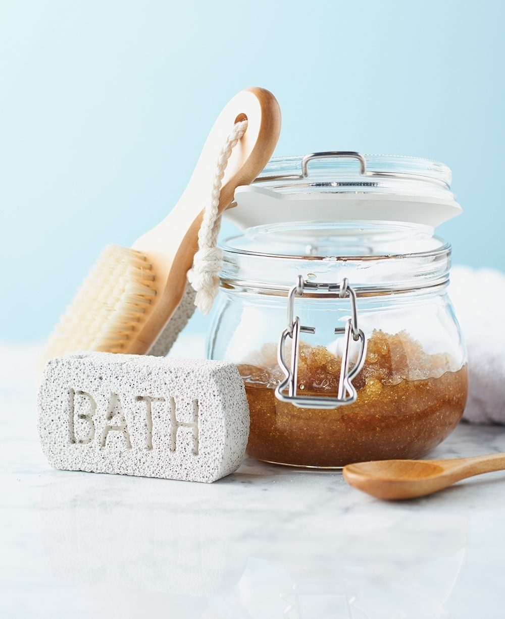 Mix a batch of this sweet exfoliant, which soothes as it removes dry skin. Use sugar for a gentler exfoliation, or substitute salt if you want a more intensive scrub for tough skin patches.