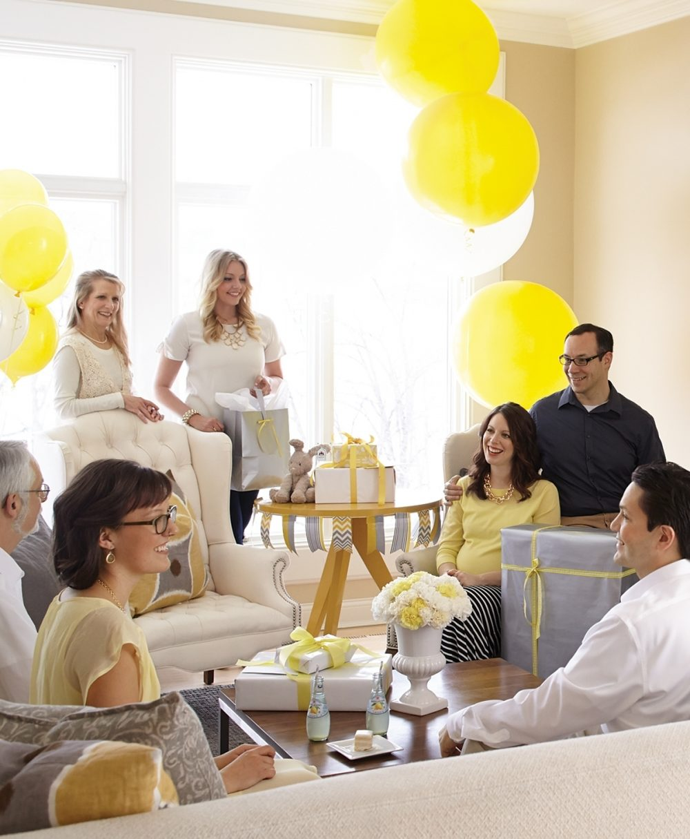 Guests gather at a co-ed baby shower