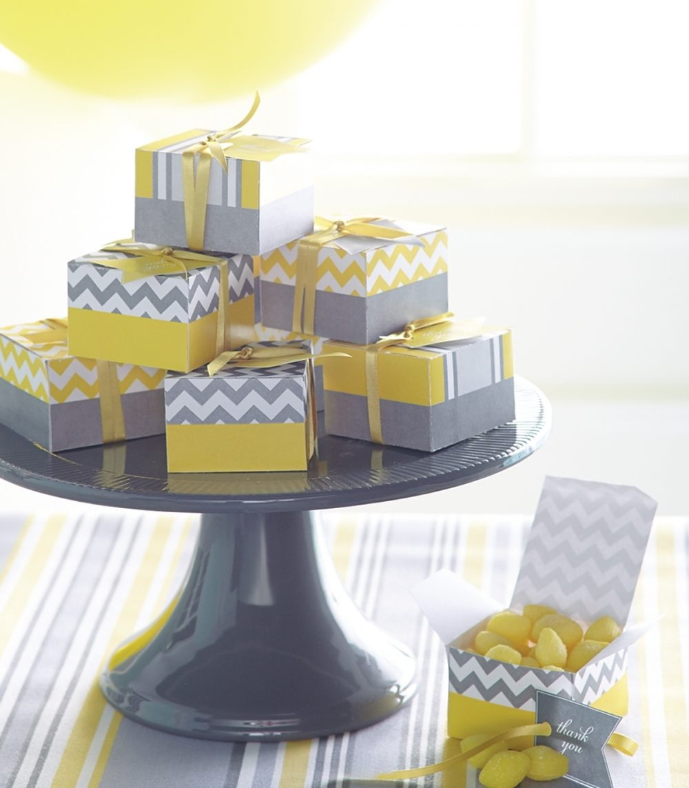 Favor boxes for a co-ed shower follow the celebration's theme of yellow and gray.