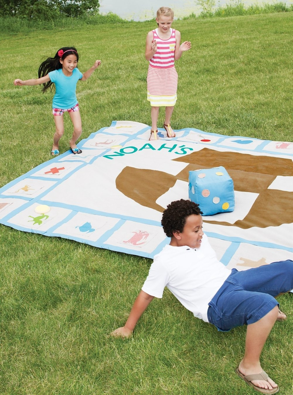 Children imitate animals during a game of Noah's 2-By-2 on a lawn.