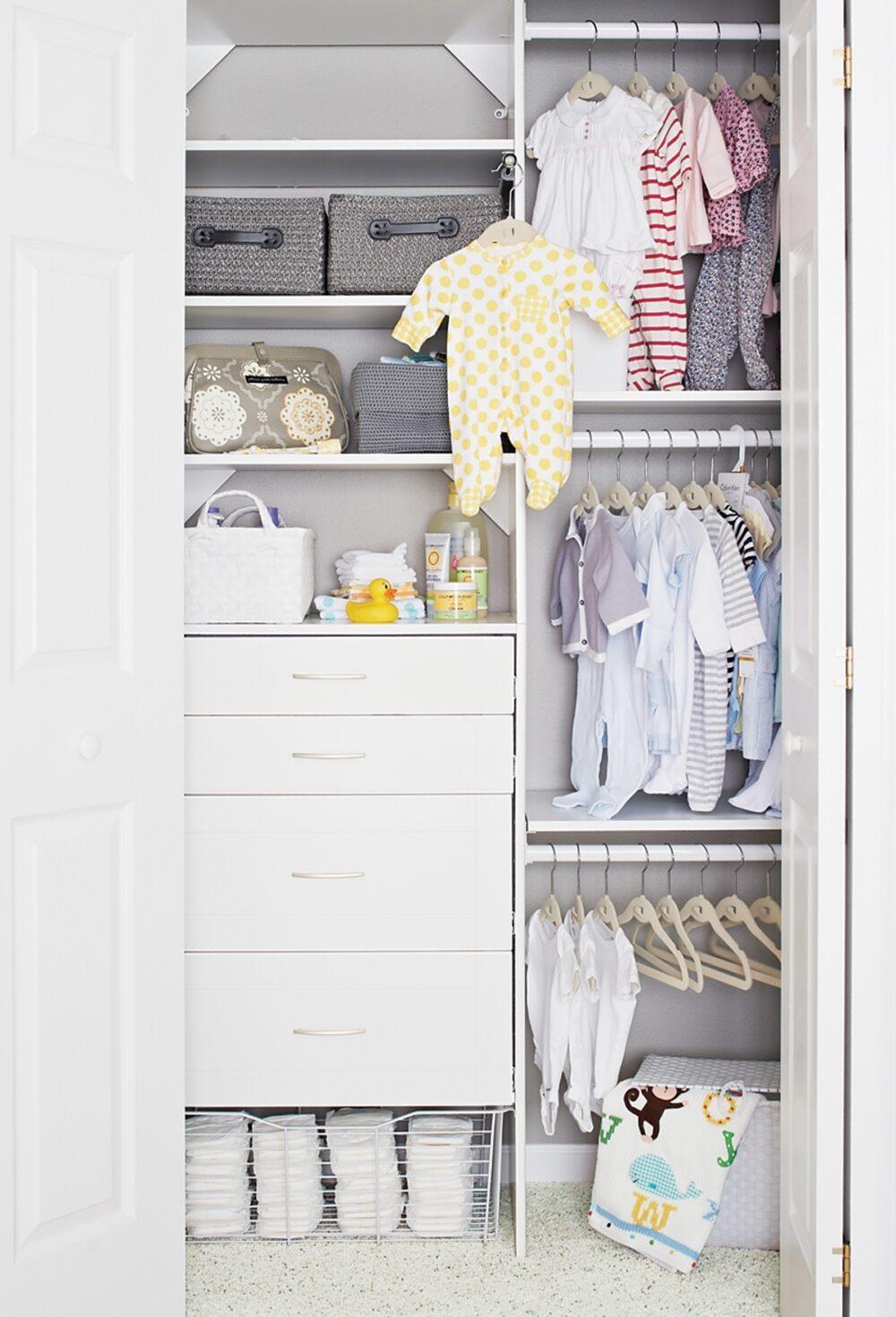 A neatly organized closet in a baby's nursery.