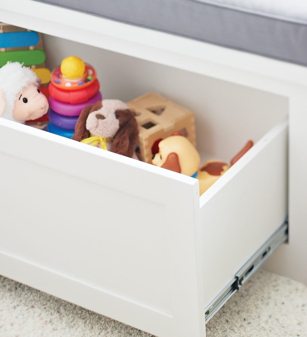 Pull-out drawers corral baby's toys.
