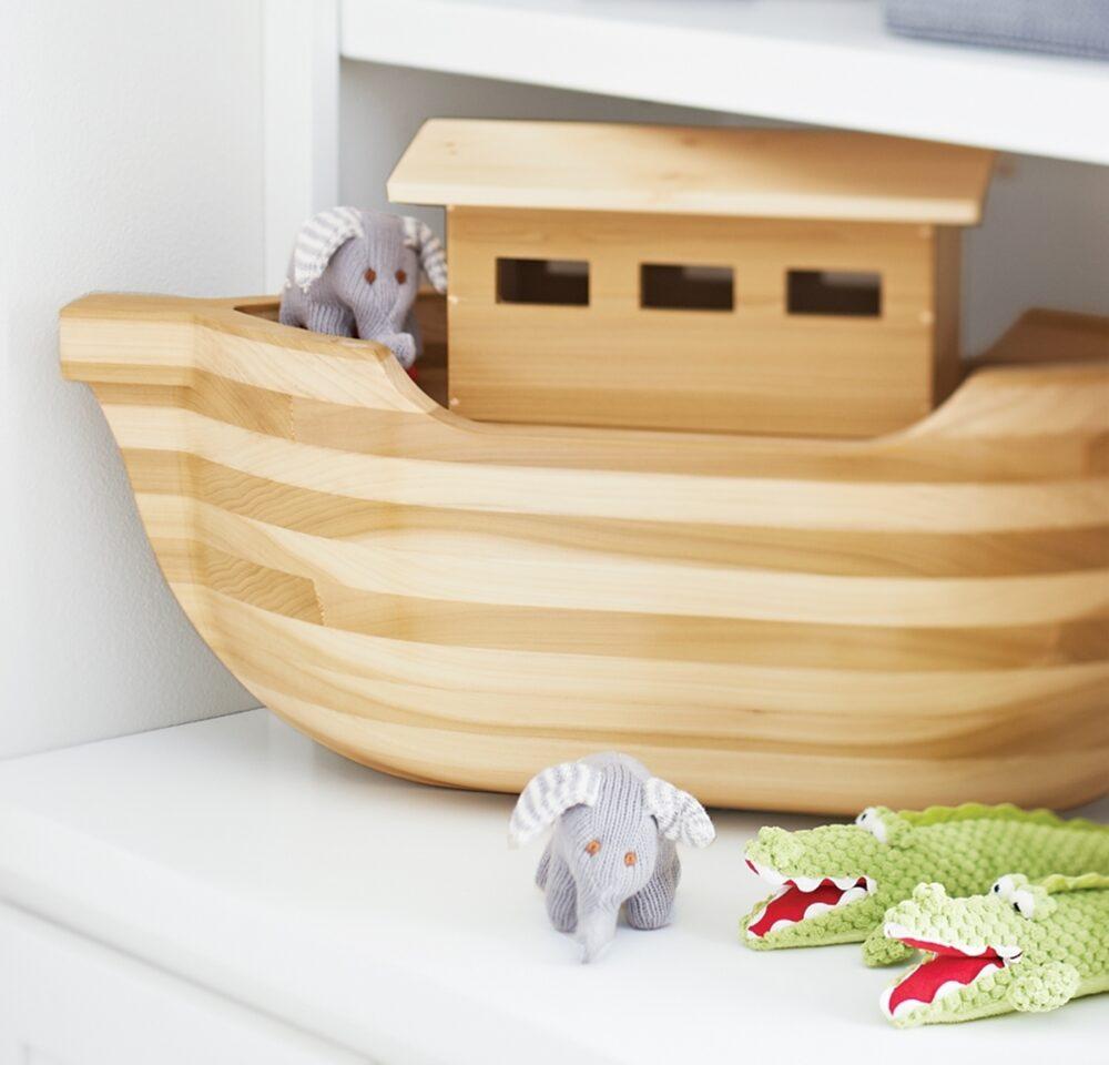 Small stuffed animals wait alongside a hand-made Noah's Ark.
