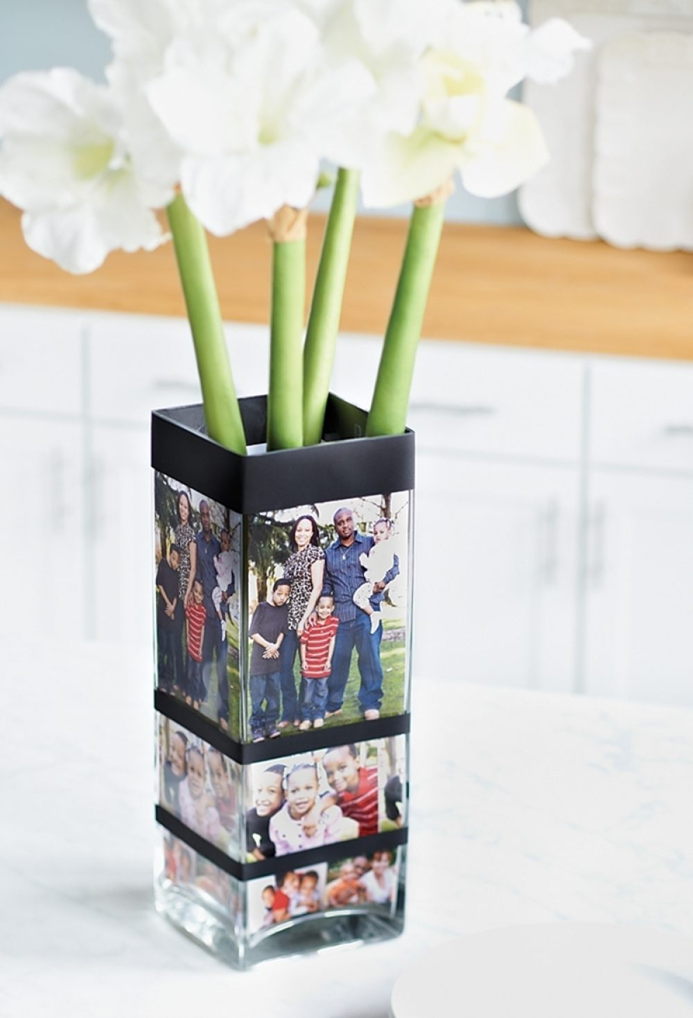 A vase is adorned with family photographs.