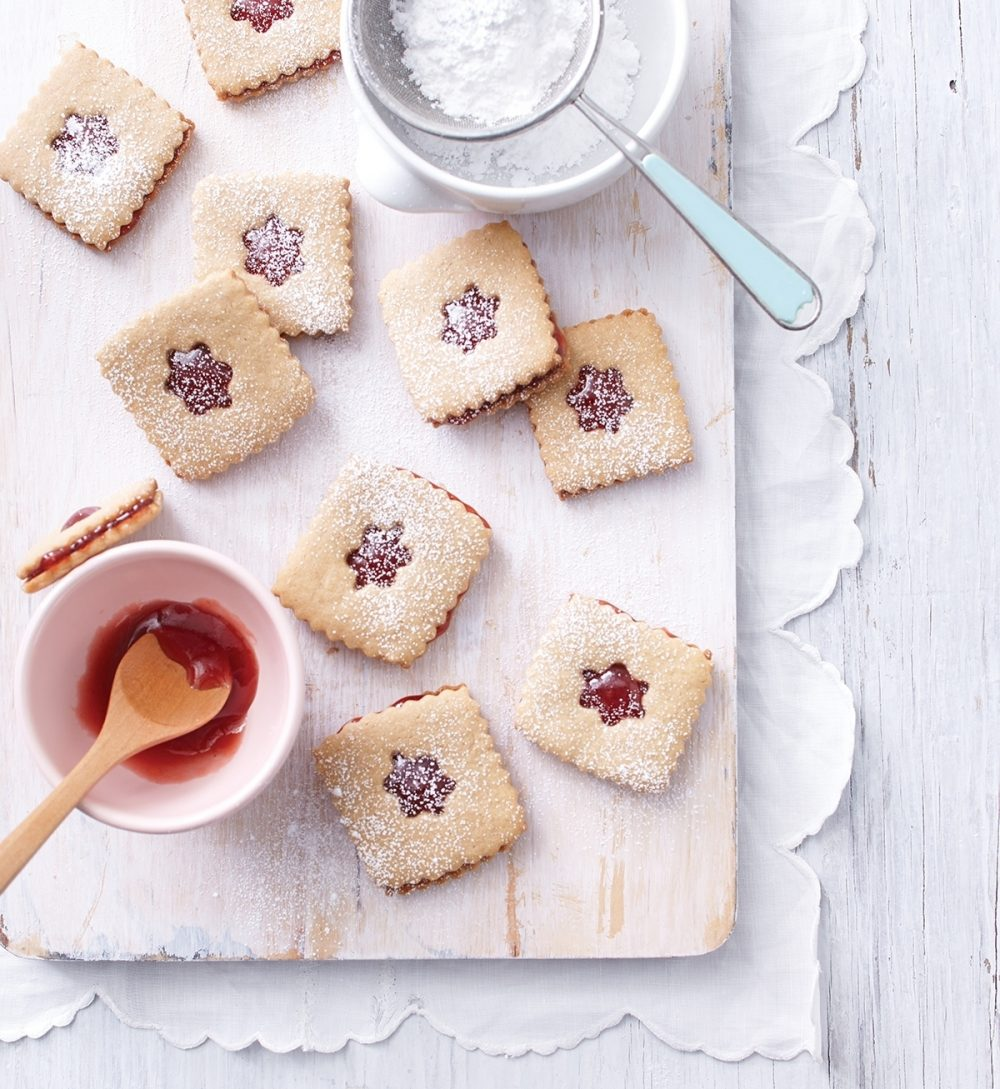 Peanut Butter & Jelly Linzer Cookies use flaky wafers to show off homemade jam or jelly.