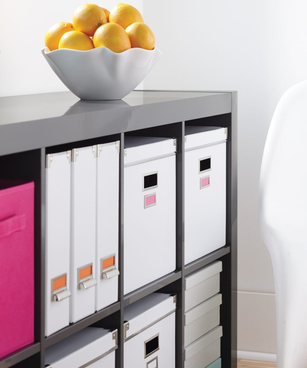 Use storage boxes, magazine holders, vertical files or horizontal files to contain the clutter and add color and interest to your office shelves and desk surface.