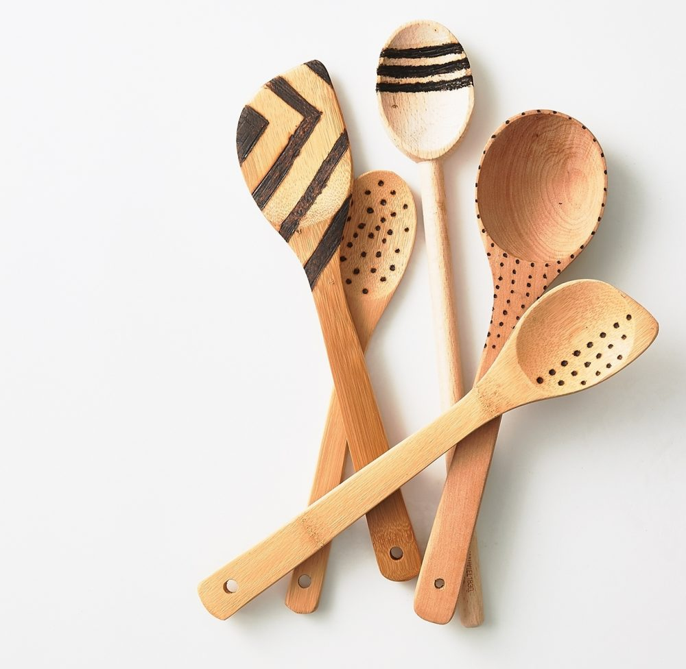 Graphic spoons: Show your creative side using a wood burning tool to burn designs into plain wooden spoons. Go tribal with dots, stripes and chevrons or personalize wooden utensils with Bible verses or the cook's initials.