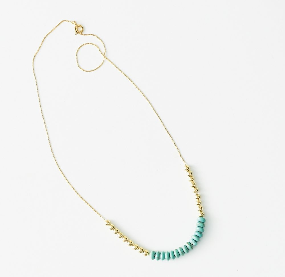 Beaded necklace: String turquoise and gold beads onto a chain and add a clasp for a stylish accessory that won't tarry in a jewelry box. Then put together matching bracelets for gifting friends and family members.