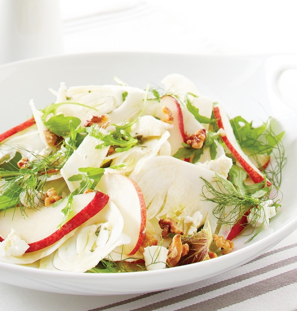 For this Pear-and-Fennel Salad, arrange baby Romaine and arugula leaves on a platter, topped with sliced red pears, thinly sliced fennel and crumbled goat cheese. Toast chopped walnuts in a skillet and toss onto greens.