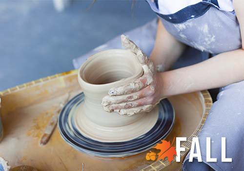 Turngin clay on a pottery wheel