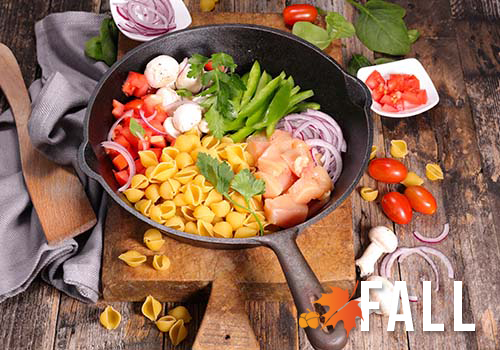Skillet full of vegetables and chicken