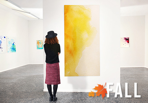 Woman looking at art piece