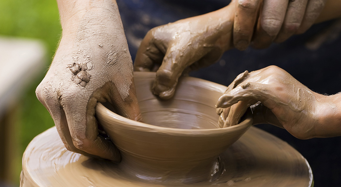 Hands working clay pottery 72px